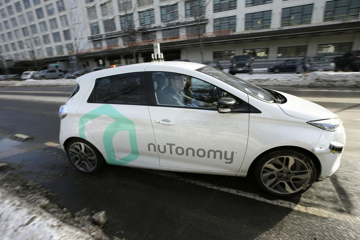 In this Tuesday, Jan. 10, 2017, photo, an autonomous vehicle is driven by an engineer on a street through an industrial park, in Boston. Researchers at Massachusetts Institute of Technology are asking human drivers how they'd handle life-or-death decision