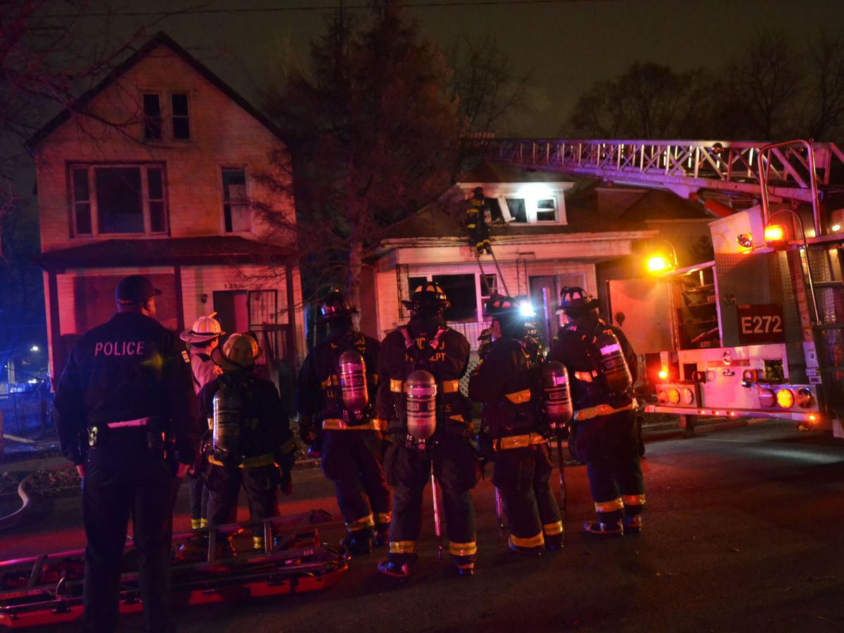 Firefighters battle 2 house fires about 5 a.m. Sunday, December 22, 2018 in the 100 block of West 117th Street in Chicago.   Justin Jackson/ Sun-Times
