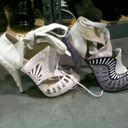 Rodarte shoes. The white on white for $659, the purple and white for $619