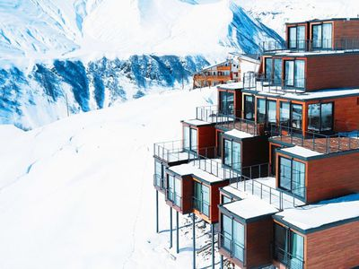Shipping containers stack up into striking ski resort lodge