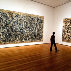 FILE - In this April, 13, 2005 file photo, a visitor strolls by canvasses by Abstract Expressionist Jackson Pollock at the Museum of Modern Art in New York. Pollock, who would have turned 100 in 2012, will have the anniversary of his birth observed with exhibitions, fundraisers and other events throughout the year.
