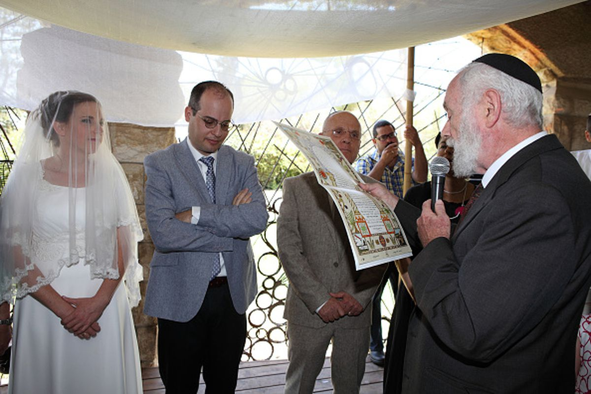 Jewish Wedding Ceremony Under A Chuppa Or Canopy At An Orthodox Rabbi Reads The Marriage Contract To Bride And Groom Jerum