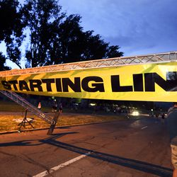 """The """"starting line"""" banner is hung before the start of the Deseret News 10K in Salt Lake City on Friday, July 23, 2021."""