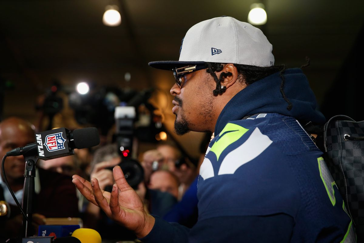 CHANDLER, AZ - JANUARY 29:  Running back Marshawn Lynch #24 of the Seattle Seahawks speaks during a Super Bowl XLIX media availability at the Arizona Grand Hotel on January 29, 2015 in Chandler, Arizona.  (Photo by Christian Petersen/Getty Images)