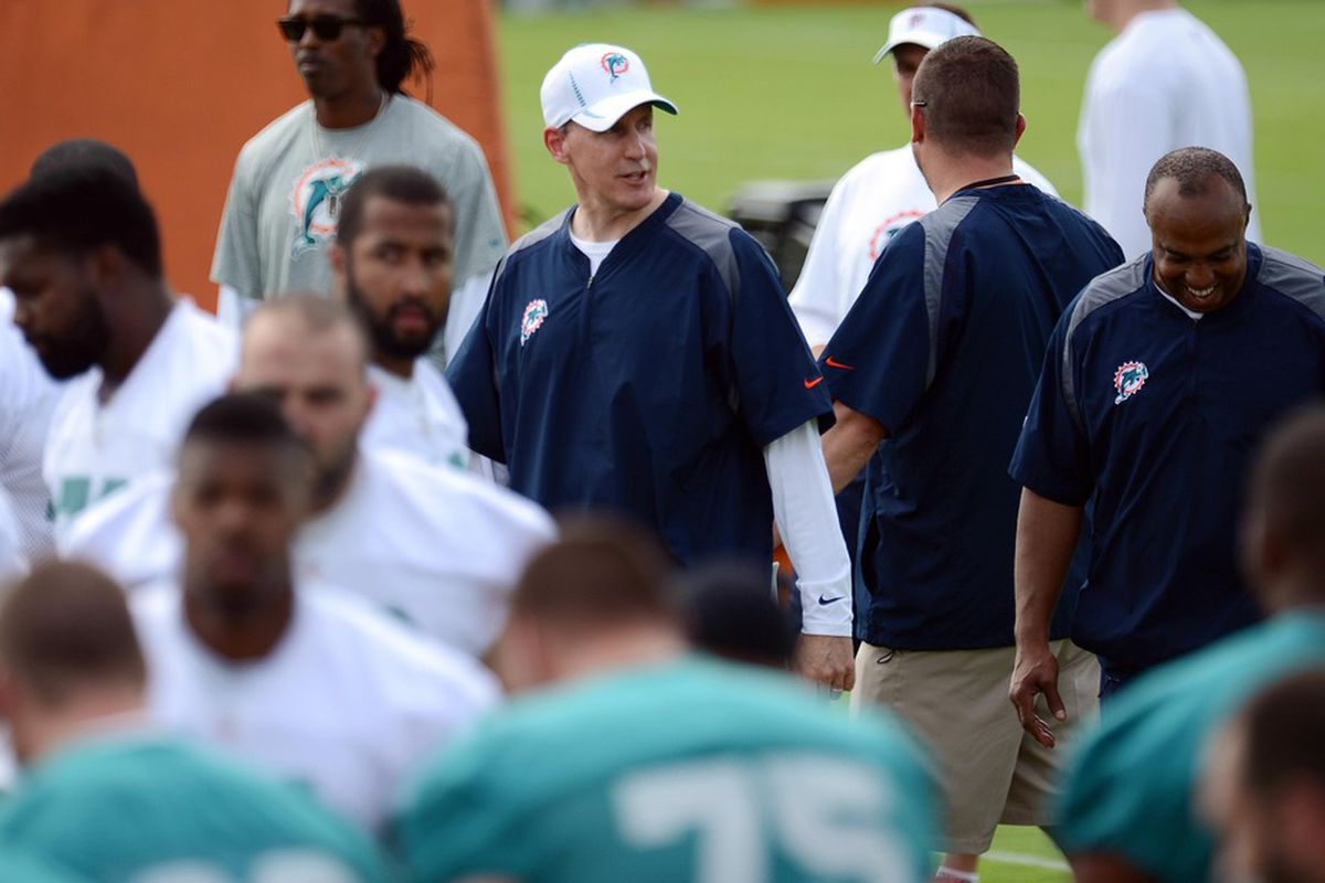 May 22, 2012; Davie, FL, USA; Miami Dolphins head coach Joe Philbin (middle) looks on during organized team activities at the Dolphins training facility. Mandatory Credit: Steve Mitchell-US PRESSWIRE
