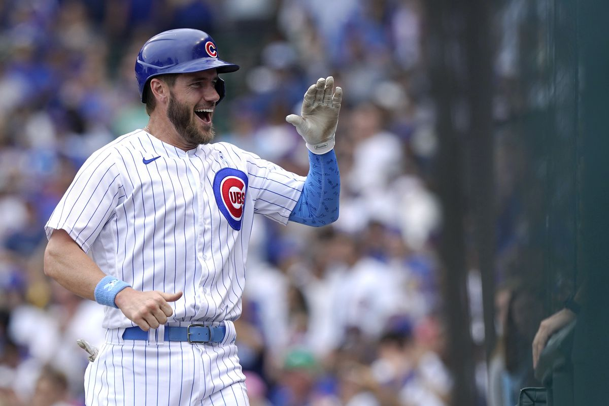Patrick Wisdom celebrates after scoring the Cubs' second run during their 2-0 win Sunday.