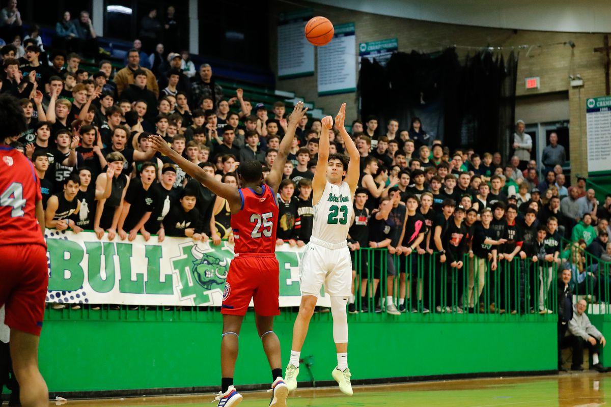 Notre Dame's Louis Lesmond (23) shoots the ball over Curie's Armond Williams (25).