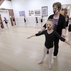 Kate Ostroski guides Emily Holbrook's arms into position as she teaches ballet at Bountiful School of Ballet, which Ostroski co-owns, in Woods Cross on Thursday, Sept. 17, 2020.
