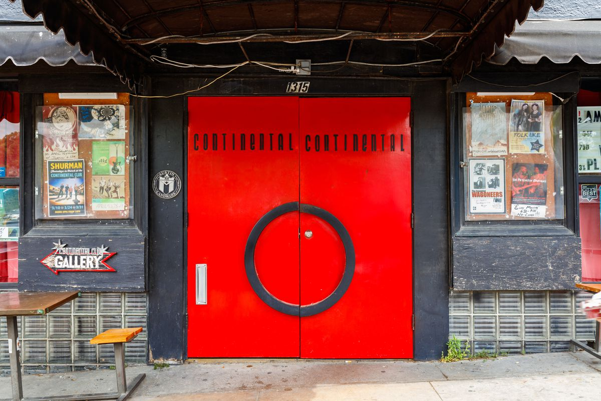A set of red doors on a black building