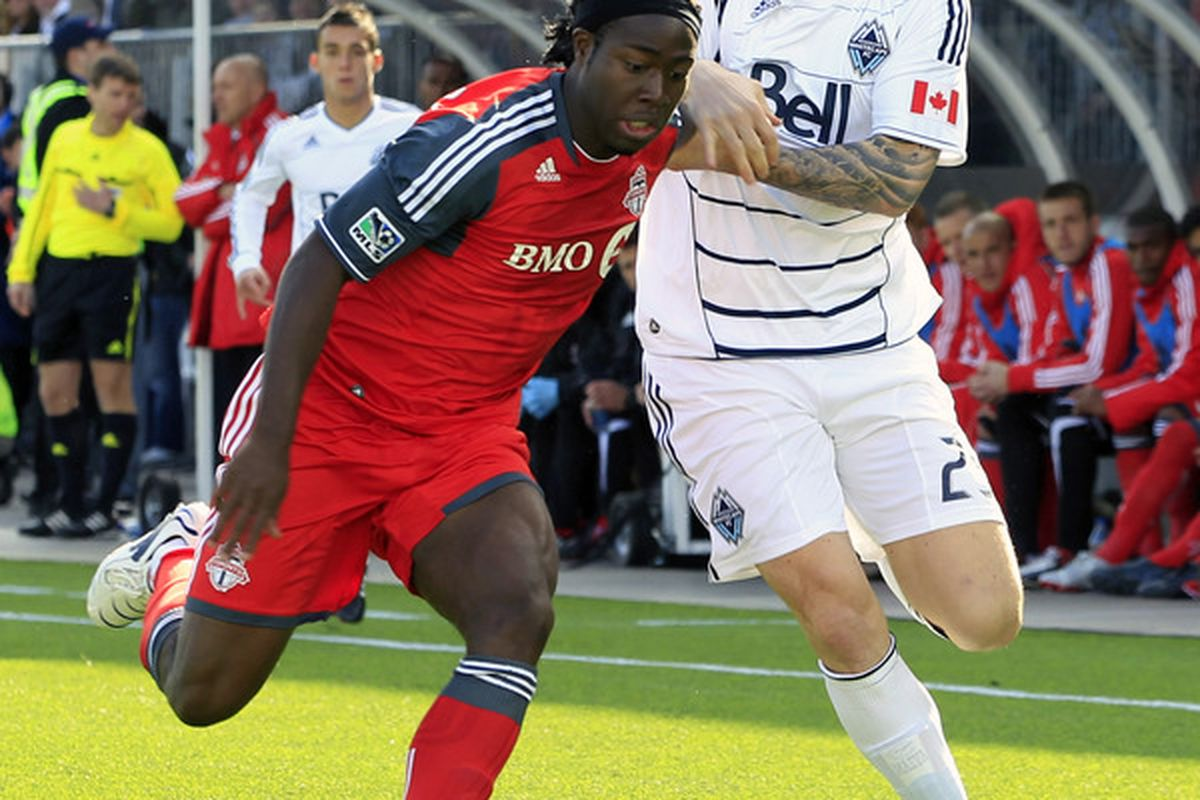VANCOUVER, BC - MARCH 19:  Eric Hassli #29 of the Vancouver Whitecaps FC and Nana Attakora #3 of the Toronto FC battle for the ball during their match March 19, 2011 in Vancouver, British Columbia, Canada.  (Photo by Jeff Vinnick/Getty Images)
