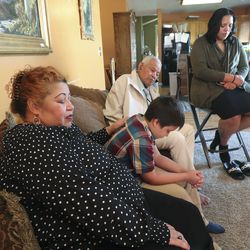 Lisia Gassant listens to the opening prayer as she and her family watches the 190th Semiannual General Conference of The Church of Jesus Christ of Latter-day Saints from their home in West Valley City on Sunday, Oct. 4, 2020.