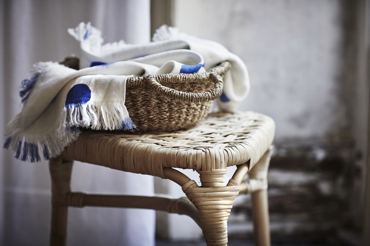 Blue and white towel in basket
