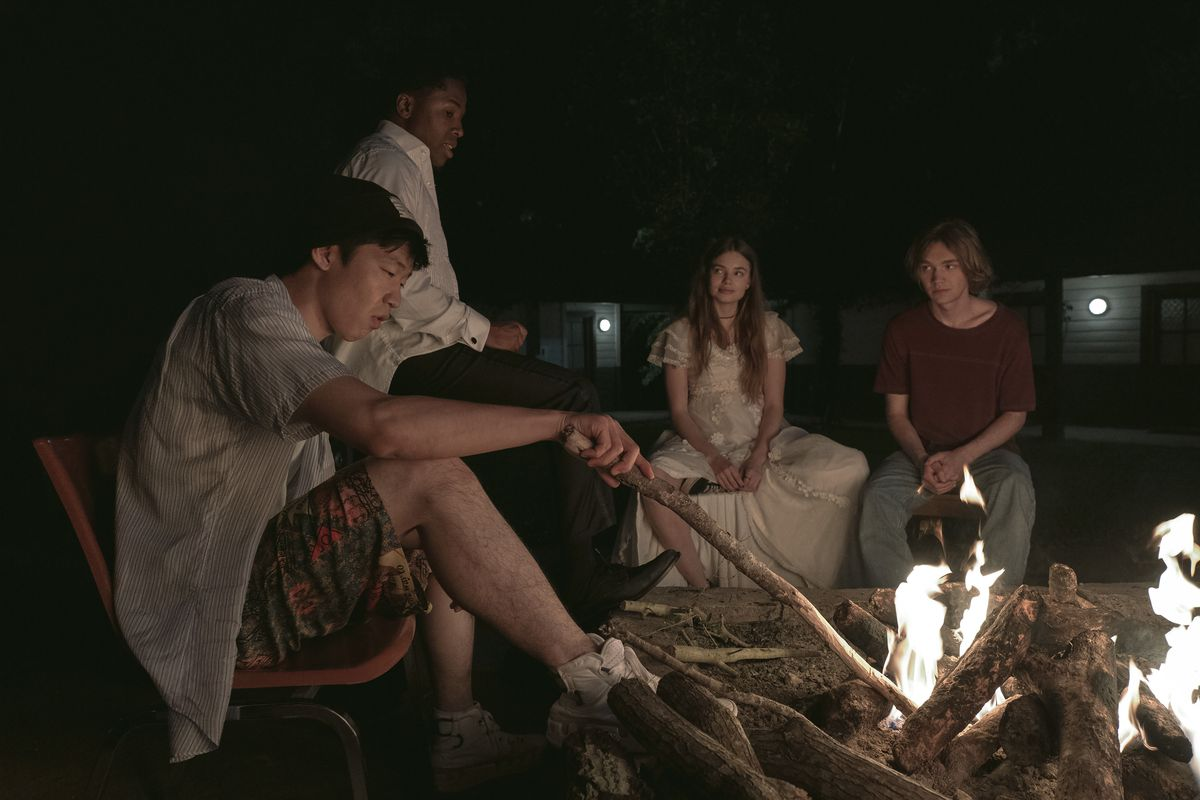 takumi, the colonel, alaska, and miles all sit around a campfire in Looking for Alaska