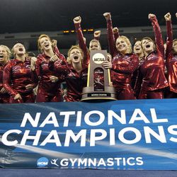 Alabama gymnasts pose with the trophy after winning the NCAA women's gymnastics championships on Saturday, April 21 2012, in Duluth, Ga.