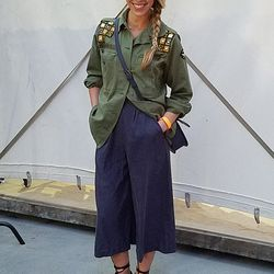 MAC's stylish PR girl pulled off proportion play with her military jacket and culottes.
