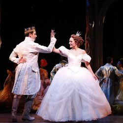 """This image released by Sam Rudy Media Relations shows Laura Osnes as Cinderella, right, dancing with Santino Fontana as the Prince, during a performance of Rodgers & Hammerstein's """"Cinderella"""" on Broadway. (AP Photo/Sam Rudy Media Relations, Carol Rosegg, file)"""
