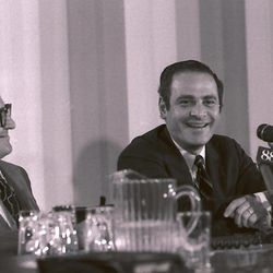 FILE - This July 1, 1971 file photo shows New York Times president and publisher Arthur Ochs Sulzberger, center, smiling at a news conference in New York, regarding the supreme court ruling permitting the Times to continue it's series of articles based on secret pentagon papers about U.S. involvement in Vietnam. Others in photo are unidentified. Sulzberger has died at age 86.  The newspaper reports that his family says Sulzberger died Saturday, Sept. 29, 2012, at his home in Southampton, N.Y., after a long illness. He had retired in 1992 after three decades at the paper's helm and was succeeded by his son, Arthur Jr.