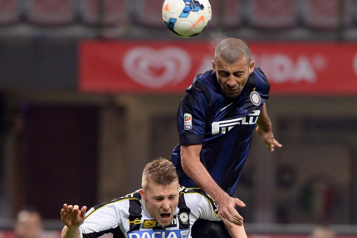 High flying defender, Walter Samuel tries to get ahead of the competition.