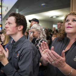 """Artist from Holdman Studios who worked on the stained glass windows react as the """"Roots of Knowledge"""" is unveiled in the library on the campus of Utah Valley University in Orem on Friday, Nov. 18, 2016."""