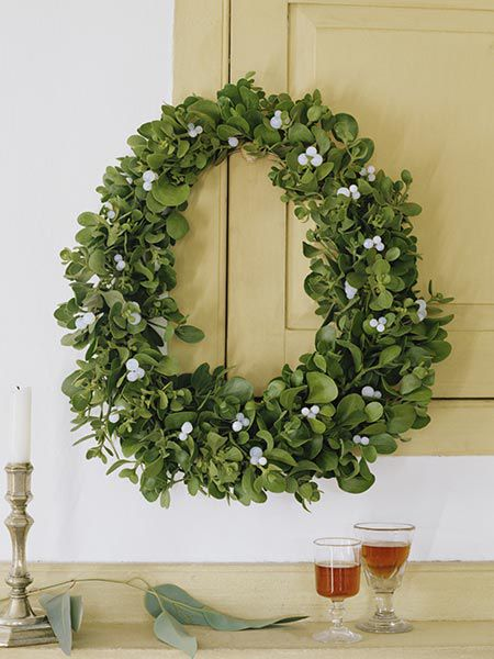 Mistletoe wreath hanging on the wall.