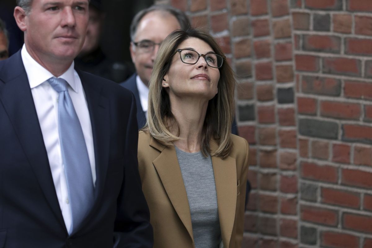 Actress Lori Loughlin departs federal court in Boston on Wednesday, April 3, 2019, after facing charges in a nationwide college admissions bribery scandal. (AP Photo/Charles Krupa)
