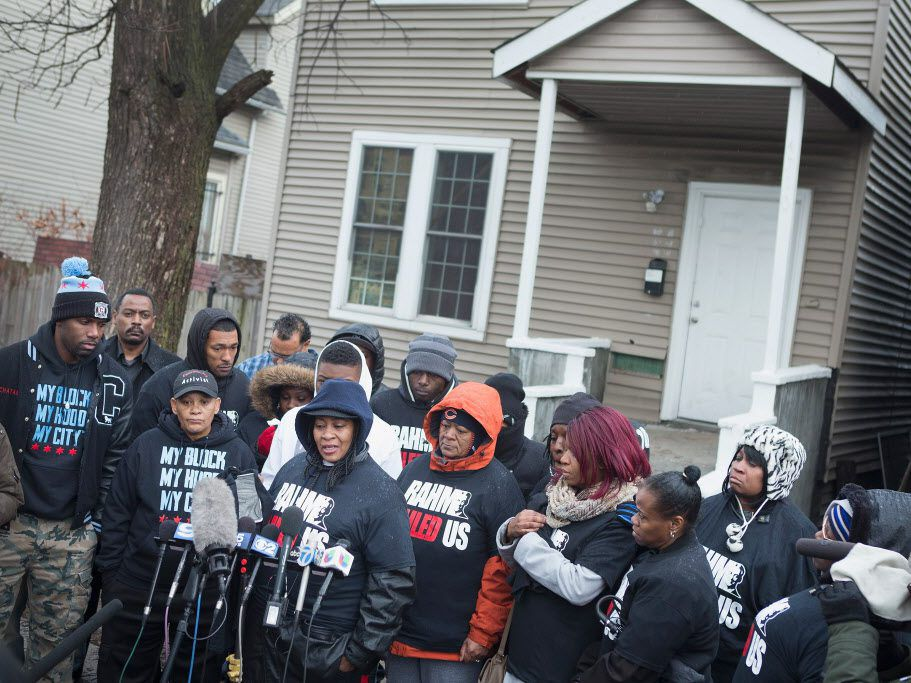Family members talk about the fatal police shootings of Quintonio LeGrier and Bettie Jones at a vigil on Dec. 27, 2015, in Chicago.   Scott Olson/Getty Images