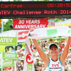 Mirinda Carfrae of Australia celebrates winning the Challenge Roth on July 20, 2014 in Roth, Germany. (Photo by Alex Grimm/Getty Images)