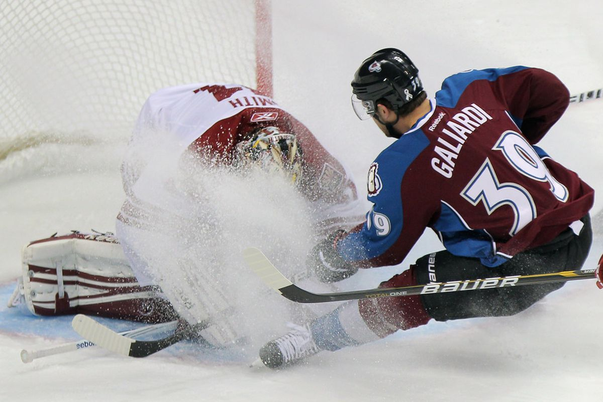 Goalie Mike Smith #41 of the Phoenix Coyotes makes a save as T.J. Galiardi #39 of the Colorado Avalanche showers him with ice as he slides to a stop at the Pepsi Center on November 2, 2011 in Denver, Colorado.  (Photo by Doug Pensinger/Getty Images)