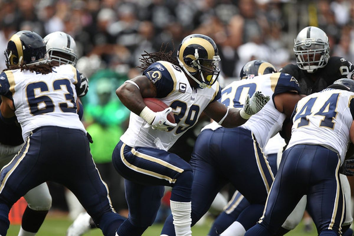 OAKLAND CA - SEPTEMBER 19:  Steven Jackson #39 of the St. Louis Rams runs against the Oakland Raiders during an NFL game at Oakland-Alameda County Coliseum on September 19 2010 in Oakland California.  (Photo by Jed Jacobsohn/Getty Images)