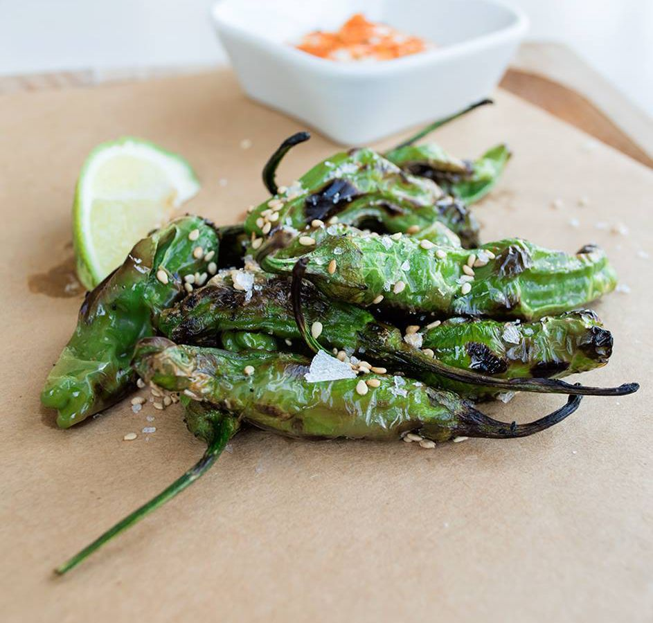 Blistered shishito peppers from Peached Tortilla