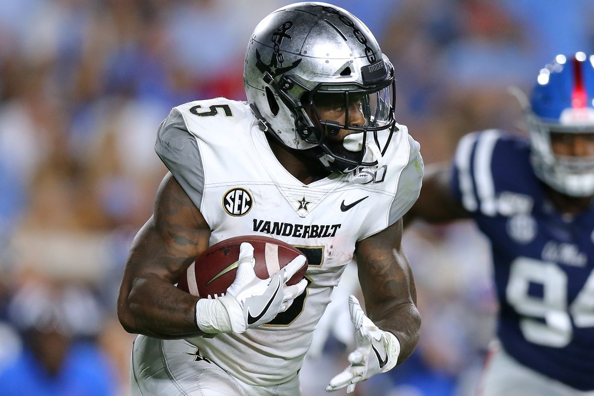Ke'Shawn Vaughn #5 of the Vanderbilt Commodores runs with the ball during the first half of a game against the Mississippi Rebels at Vaught-Hemingway Stadium on October 05, 2019 in Oxford, Mississippi.