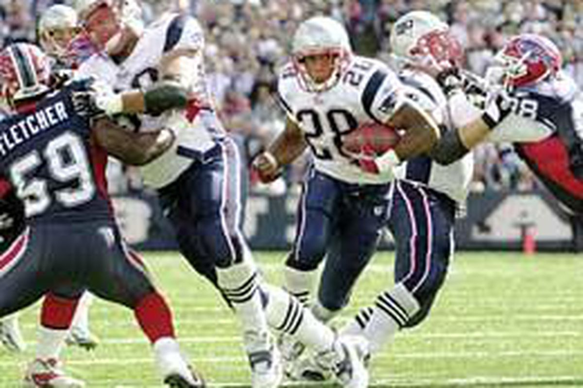 Ex-Dixie running back Corey Dillon (28) runs for a Patriots' touchdown during the first half of Sunday's game against the Buffalo Bills.