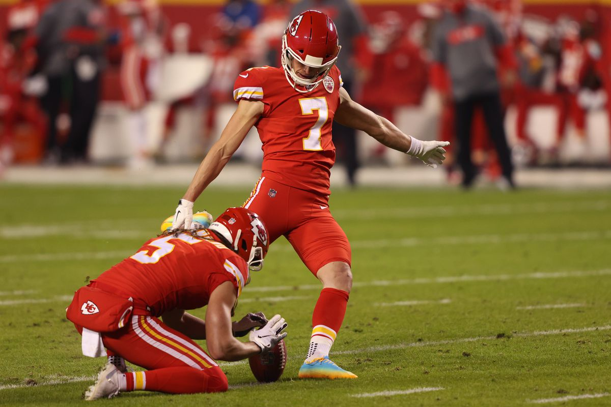 Harrison Butker #7 of the Kansas City Chiefs kicks a field goal ahead of place holder Tommy Townsend #5 during the second quarter of a game against the Denver Broncos at Arrowhead Stadium on December 06, 2020 in Kansas City, Missouri.