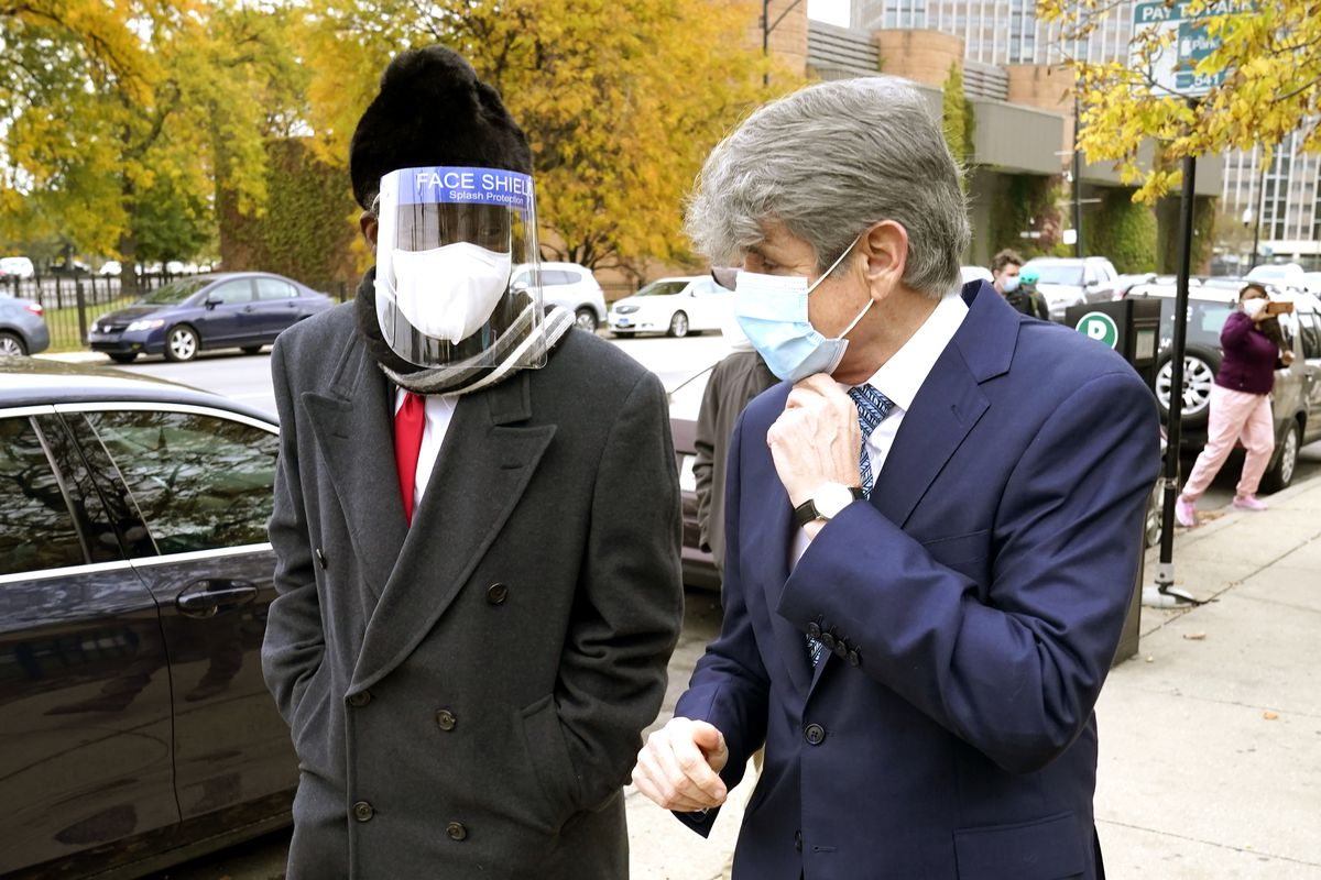 Chicago businessman Willie Wilson, left, walks with former Illinois Gov. Rod Blagojevich earlier this month.