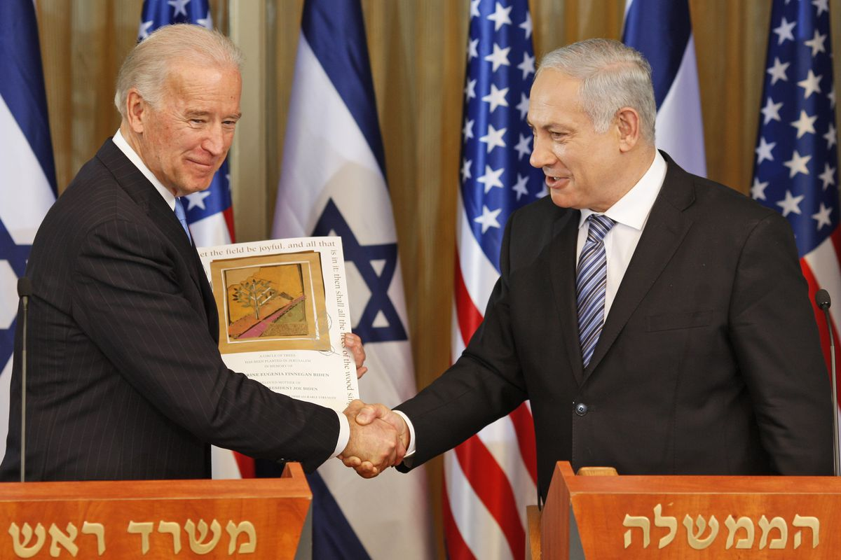 Then-U.S Vice President Joe Biden shakes hand with Israel's Prime Minister Benjamin Netanyahu at the Prime Ministers residence in Jerusalem on March 9, 2010.