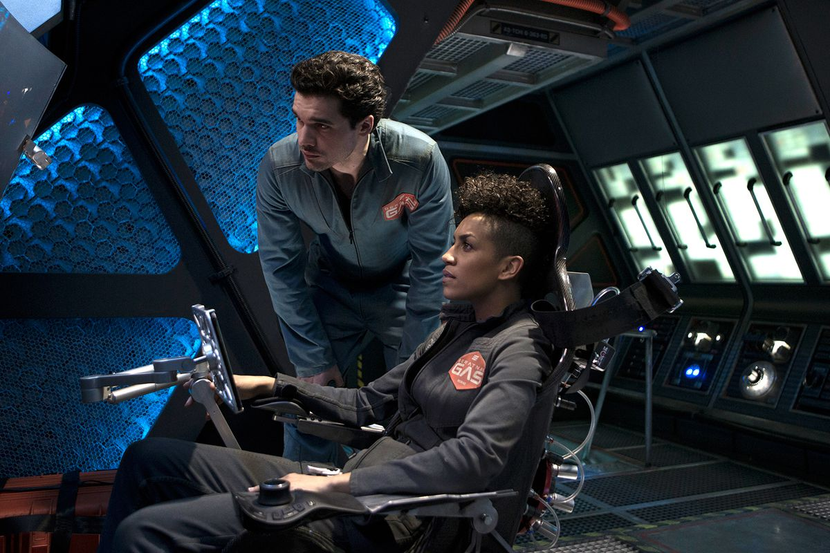 two spaceship pilots sit in the cockpit in the expanse