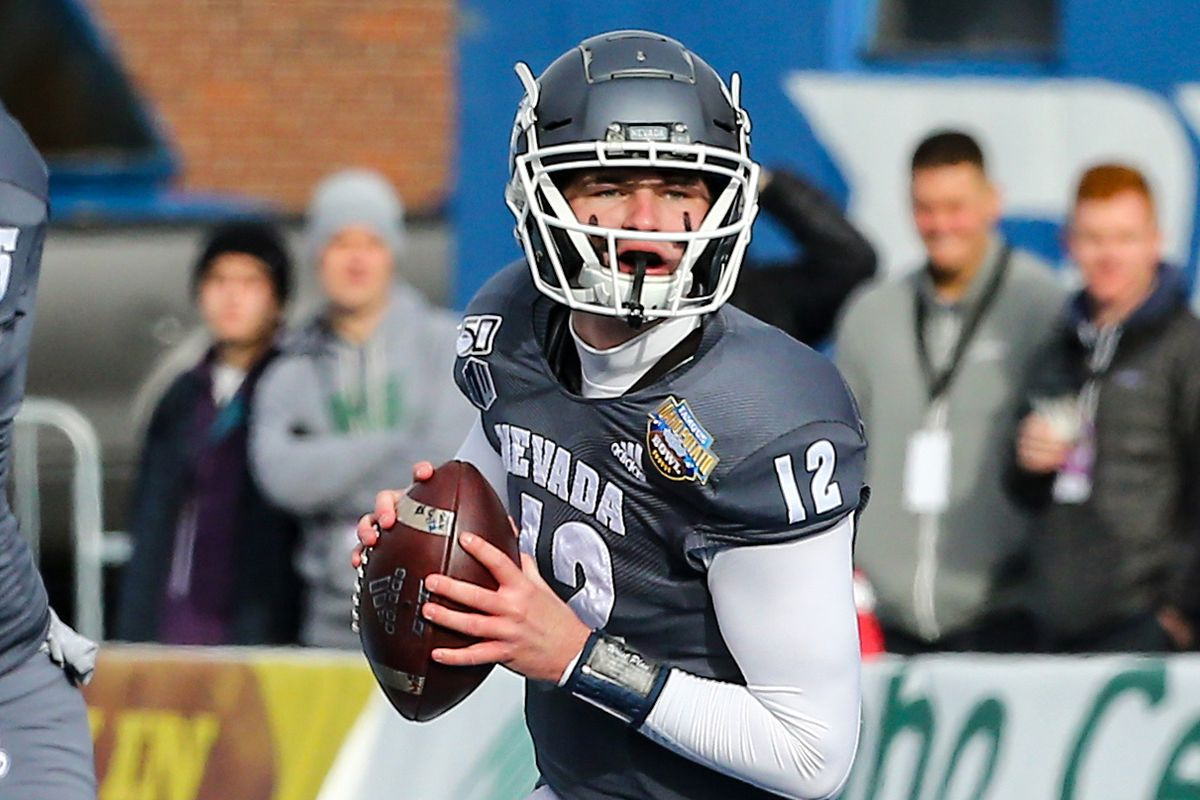 Nevada Wolf Pack quarterback Carson Strong (12) drops back to pass during the first half of the Famous Idaho Potato Bowl against the Ohio Bobcats at Albertsons Stadium.