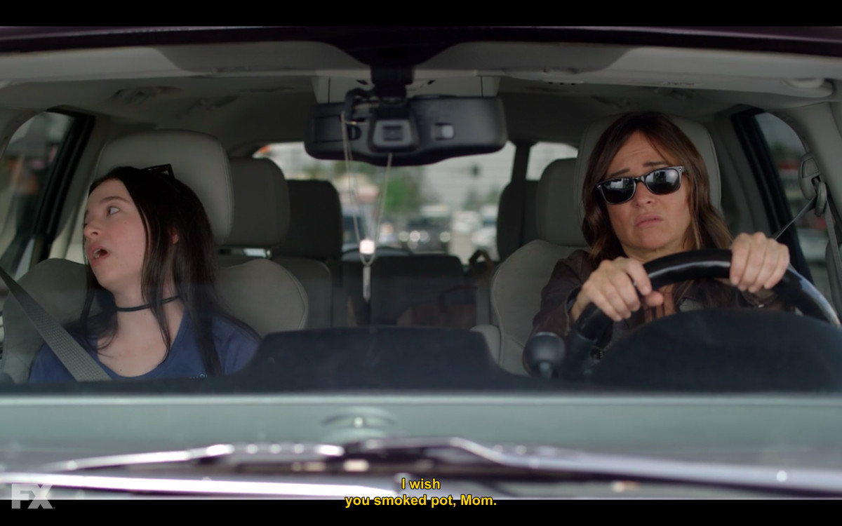 Sam Fox and one of her daughters in the car
