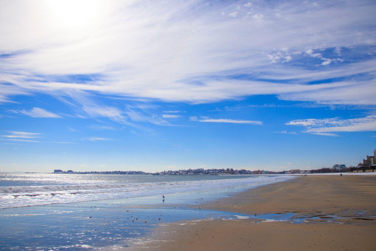A sandy beach near a body of water.