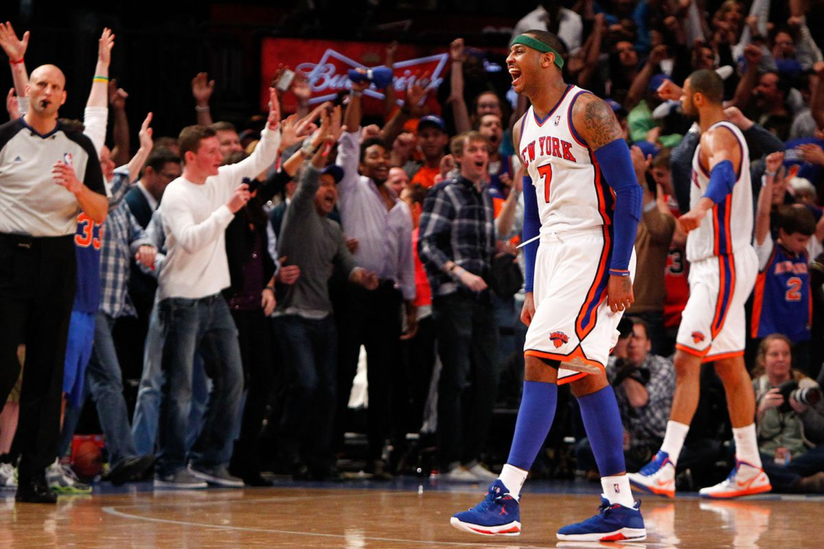 Apr. 8, 2012; New York, NY, USA; New York Knicks small forward Carmelo Anthony (7) reacts after winning the game in overtime against the Chicago Bulls at Madison Square Garden. Knicks won in overtime 100-99. Mandatory Credit: Debby Wong-US PRESSWIRE