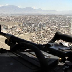 A U.S. Chinook helicopter flies over Kabul, Afghanistan, during a visit of NATO Secretary-General Anders Fogh Rasmussen, Thursday, April 12, 2012. NATO said Thursday it is on track to fully hand over responsibility for securing Afghanistan to local forces by the end of 2014 as scheduled.