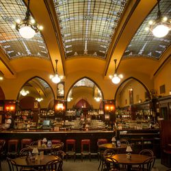 Portland's oldest restaurant Huber's Cafe — founded in 1879, and at its current Old Pioneer Building location since 1910 — evokes another era with its arches, stained-glass skylights, and dark-wood paneling.