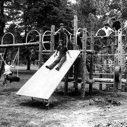 Children enjoy a new playground apparatus installed in Liberty Park in 1978.