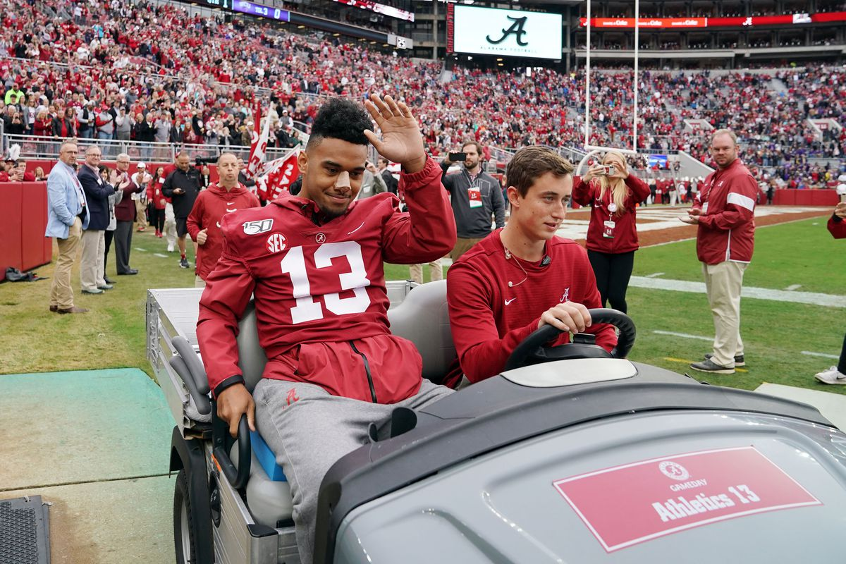 Alabama Crimson Tide quarterback Tua Tagovailoa  waves to the crowds as he is carted onto the field before the start of their game against the Western Carolina Catamounts at Bryant-Denny Stadium.
