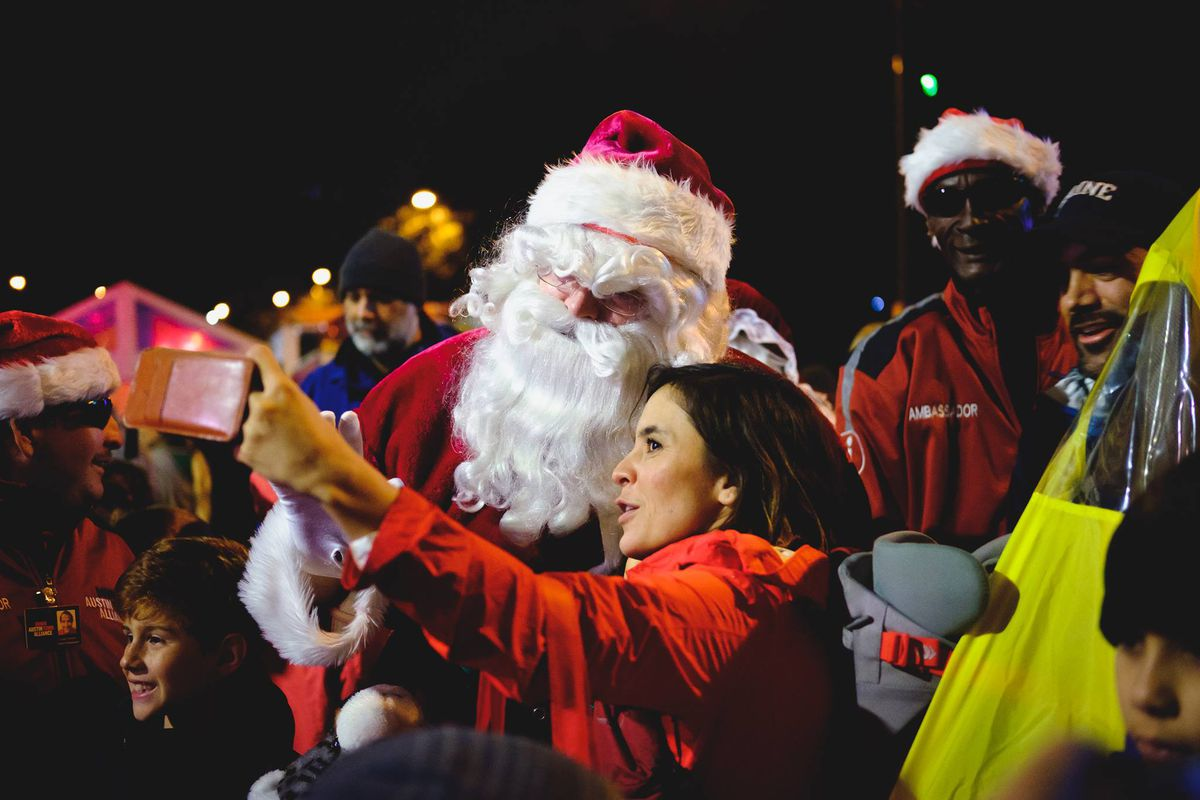 Santa and a woman taking a selfie