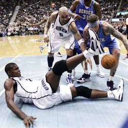 Paul Millsap #24 of the Utah Jazz falls to the floor after trying to get the rebound as the Jazz-Nuggets play in game 3 of the Western Conference Playoffs in Energy Solutions Arena.