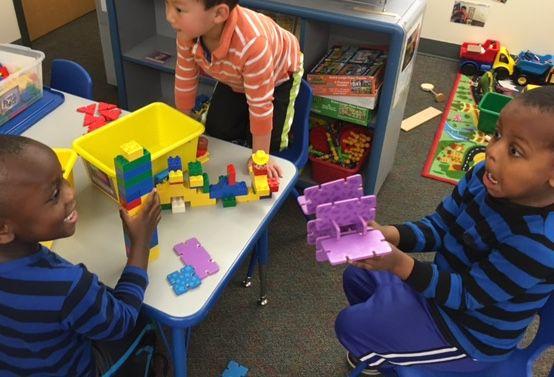 Two preschoolers joke around at Laredo Child Development Center