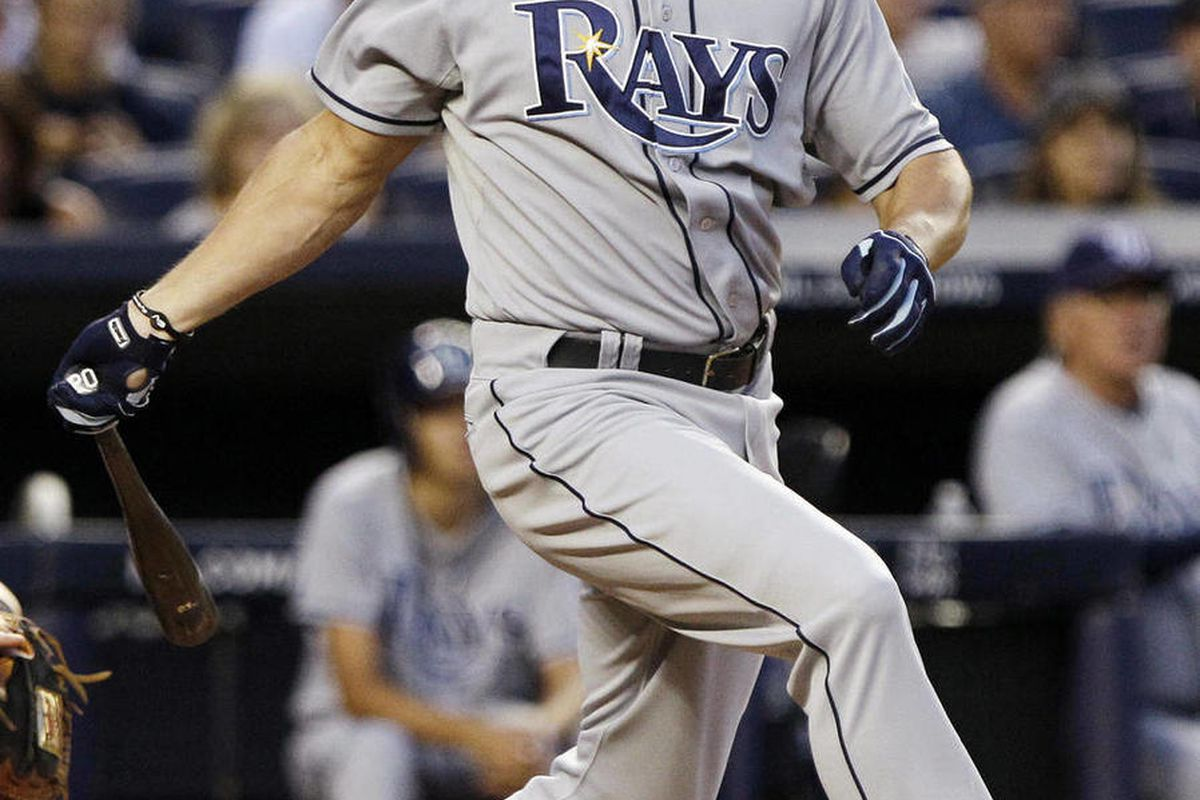 FILE - In this Aug. 12, 2011, file photo, Tampa Bay Rays' Johnny Damon follows through on a home run during the third inning of a baseball game against the New York Yankees at Yankee Stadium in New York. According to a text to the Associated Press from Da