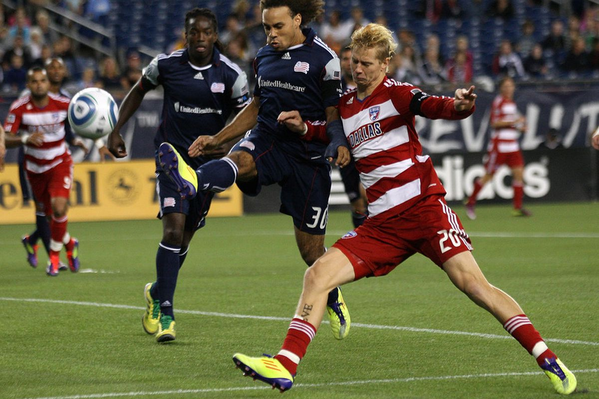 FOXBORO, MA - SEPTEMBER 10:  Kevin Alston #30 of the New England Revolution defends against Brek Shea #20 of the FC Dallas at Gillette Stadium on September 10, 2011 in Foxboro, Massachusetts. (Photo by Jim Rogash/Getty Images)