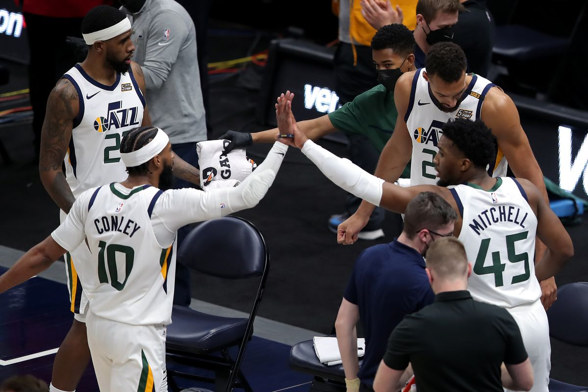The Utah Jazz's Mike Conley (10) and Donovan Mitchell (45) high-five in Salt Lake City on Saturday, April 10, 2021.